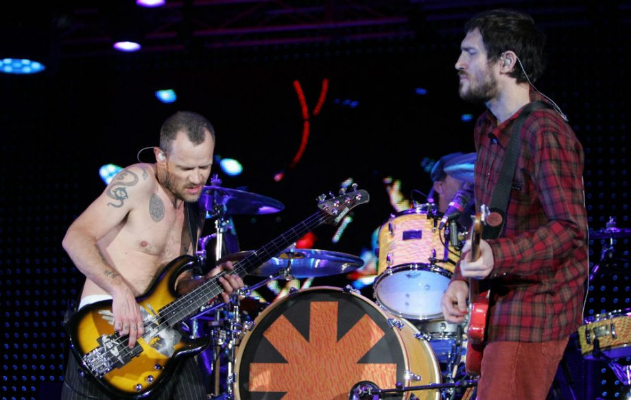 Red Hot Chili Peppers' Flea and former guitarist John ...