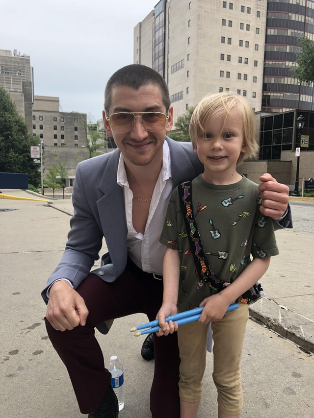 Alex Turner poses with six year old fan