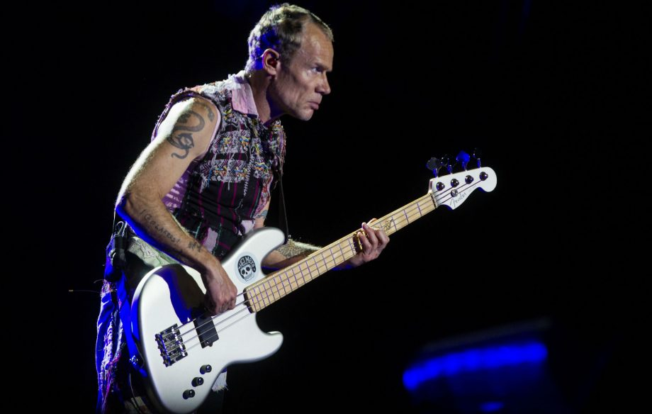 Red Hot Chili Peppers' Flea entertains crowd with handstands as band's show cuts out after one song