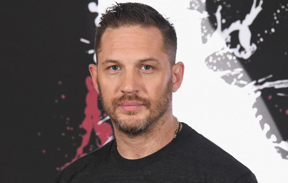 Tom Hardy collects CBE from Buckingham Palace