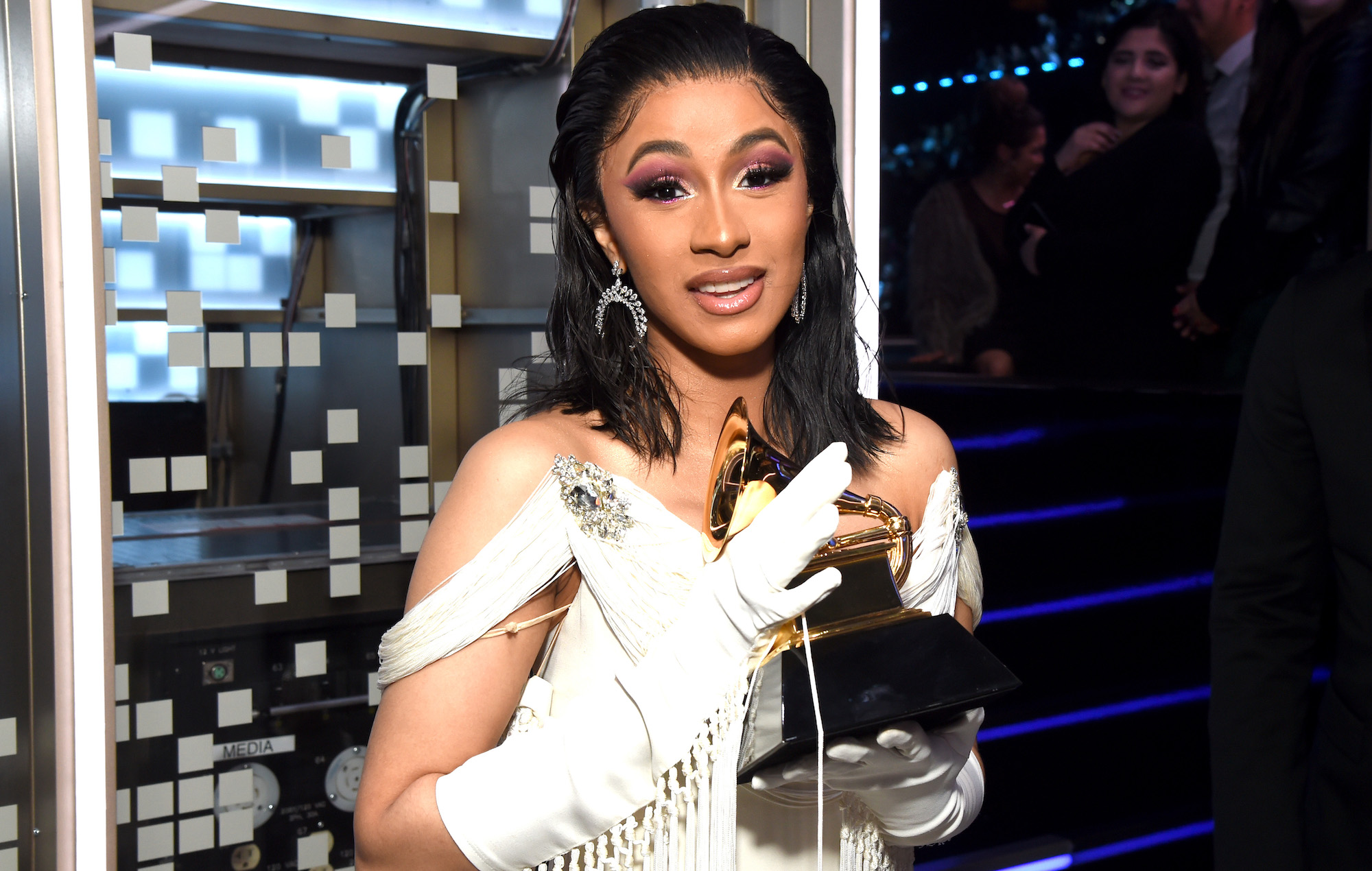 "Cardi B Unveils Her Entire Back Tattoo With Bright Pink: Cardi B Says She's Writing A Book About Her Life: ""I've"