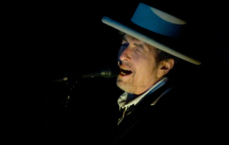 Bob Dylan calls out fans for taking photos after nearly falling over at gig