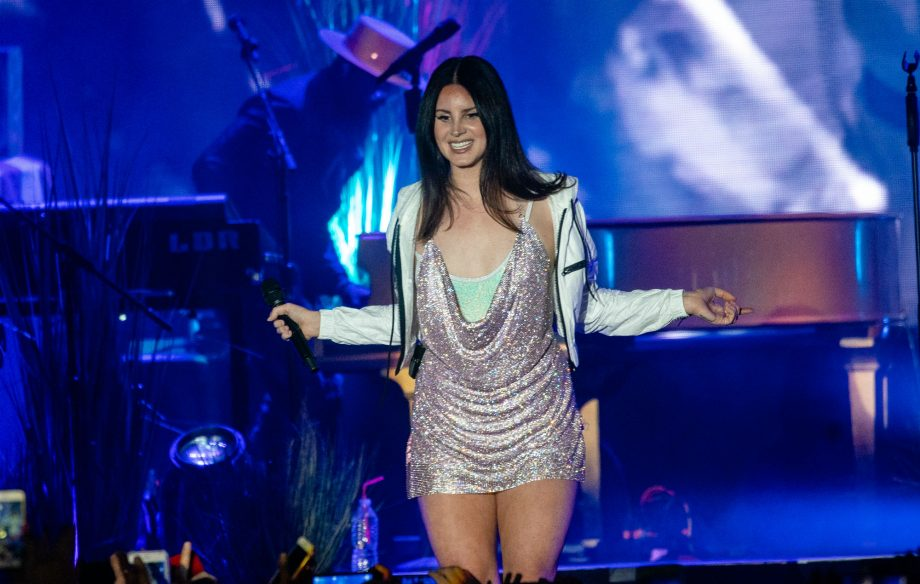 Watch A Giant Lana Del Rey Stride Through The Streets Of