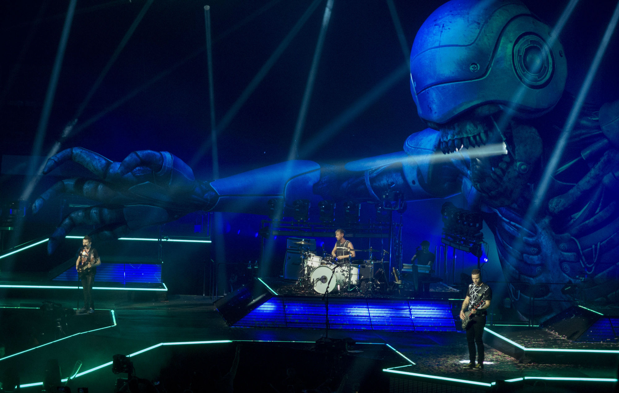 Confetti banknotes! Drones! The all-seeing-eye! A brief history of Muse's brilliantly bizarre tours