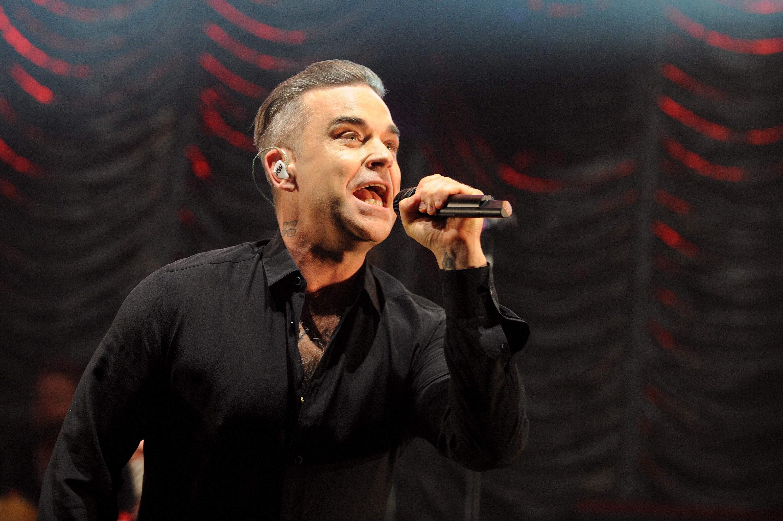 Robbie Williams wants to headline Glastonbury – but won't accept a legends slot