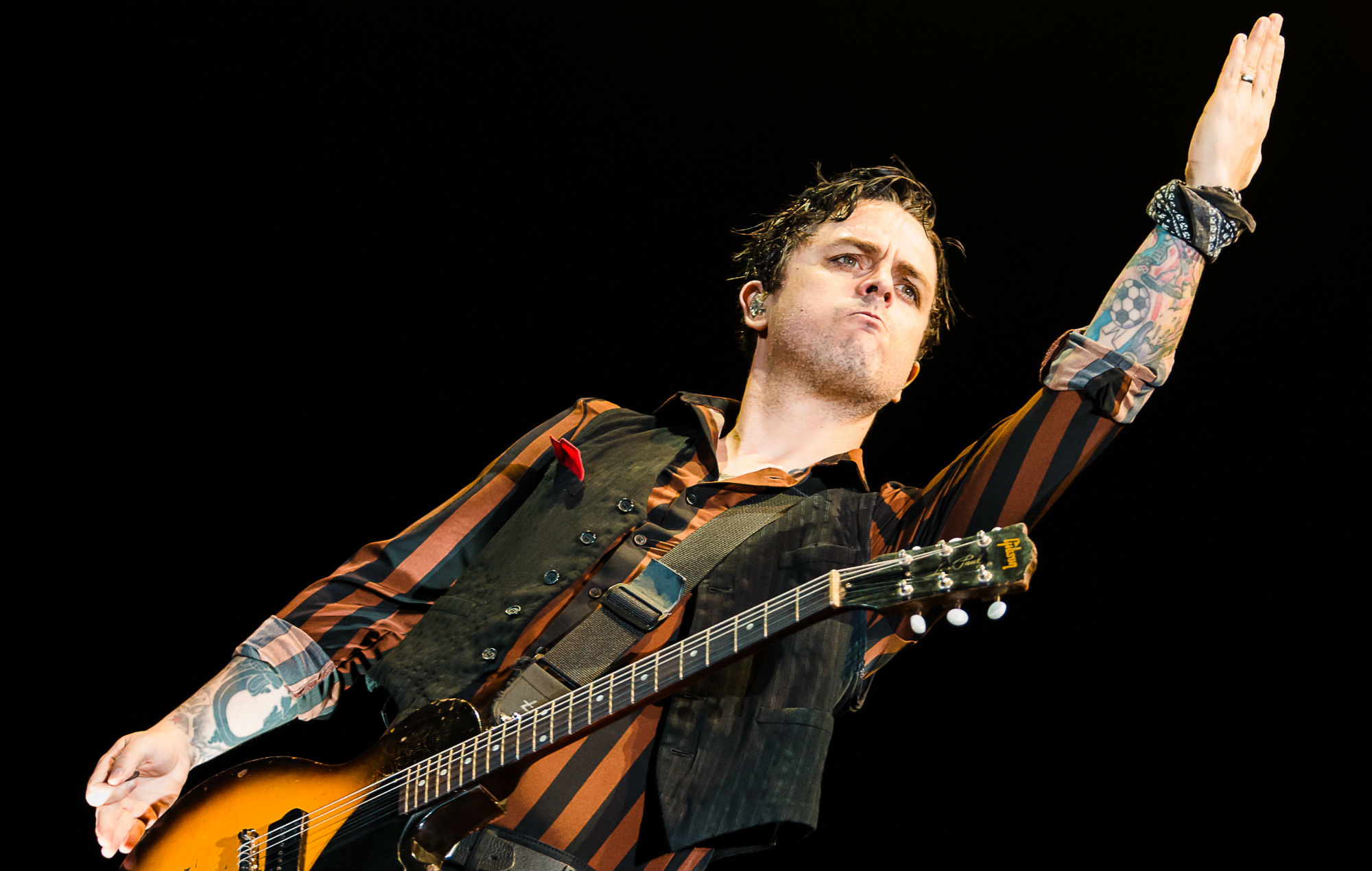 Watch Green Day Members Make Surprise Appearance At Party