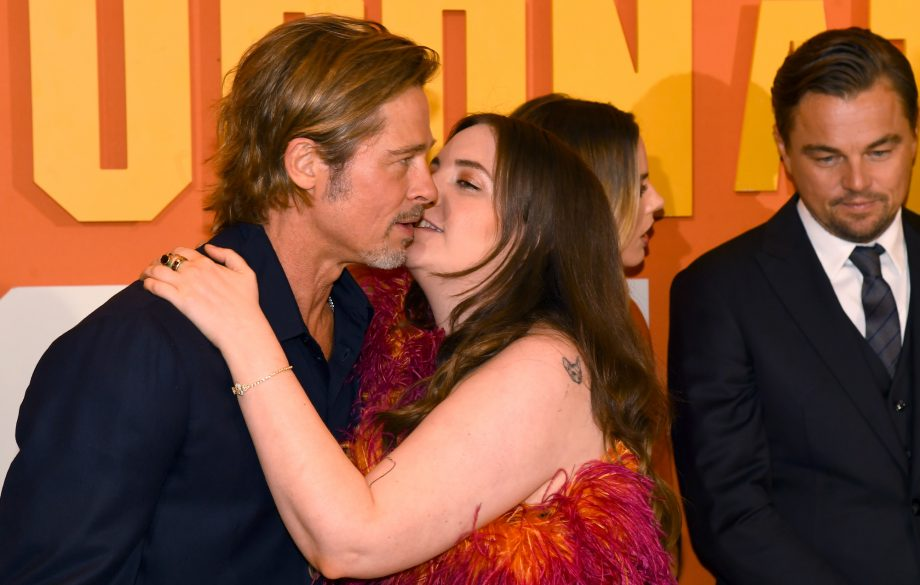 A photograph of Lena Dunham attempting to kiss Brad Pitt sparks debate about double standards
