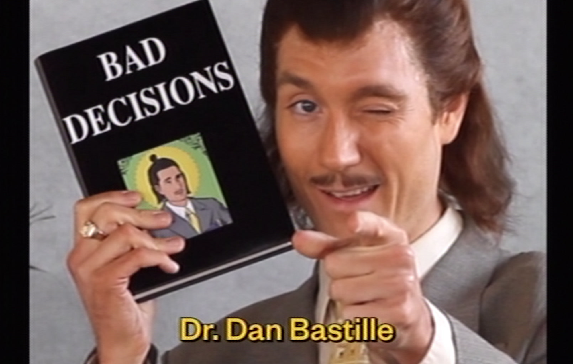 Watch Bastille's Dan Smith play a self-help guru in the video for 'Bad Decisions'