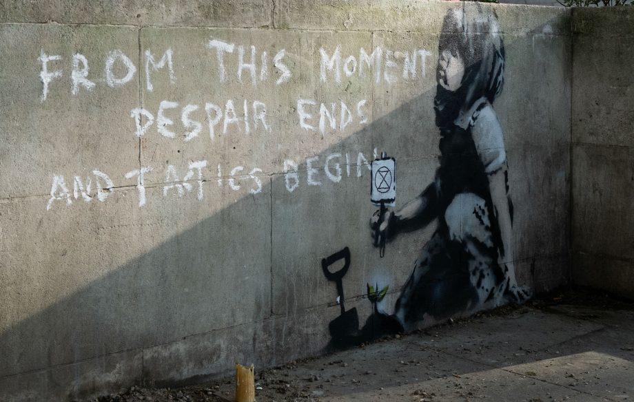 Banksy's Extinction Rebellion mural placed in protective casing
