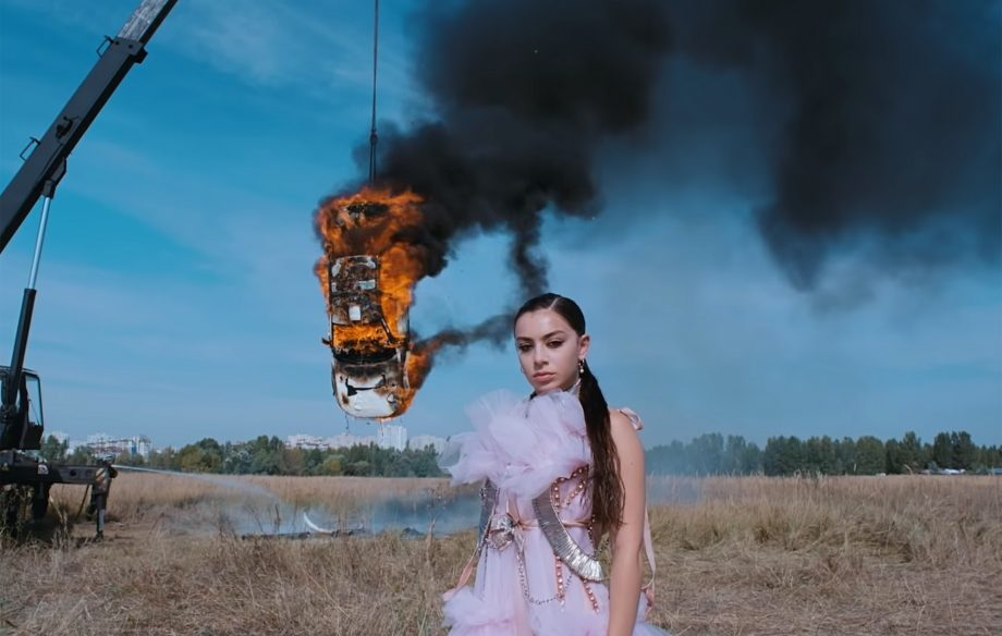 Charli XCX addresses air pollution concerns over burning car in 'White Mercedes' video