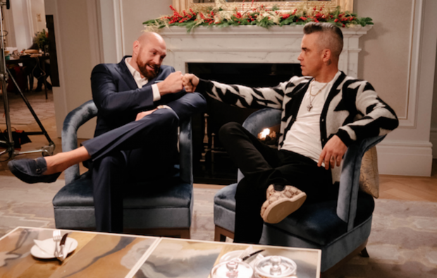 https://ksassets.timeincuk.net/wp/uploads/sites/55/2019/11/Robbie-Williams-and-Tyson-Fury-collaborate-Bad-Sharon-620x394.png