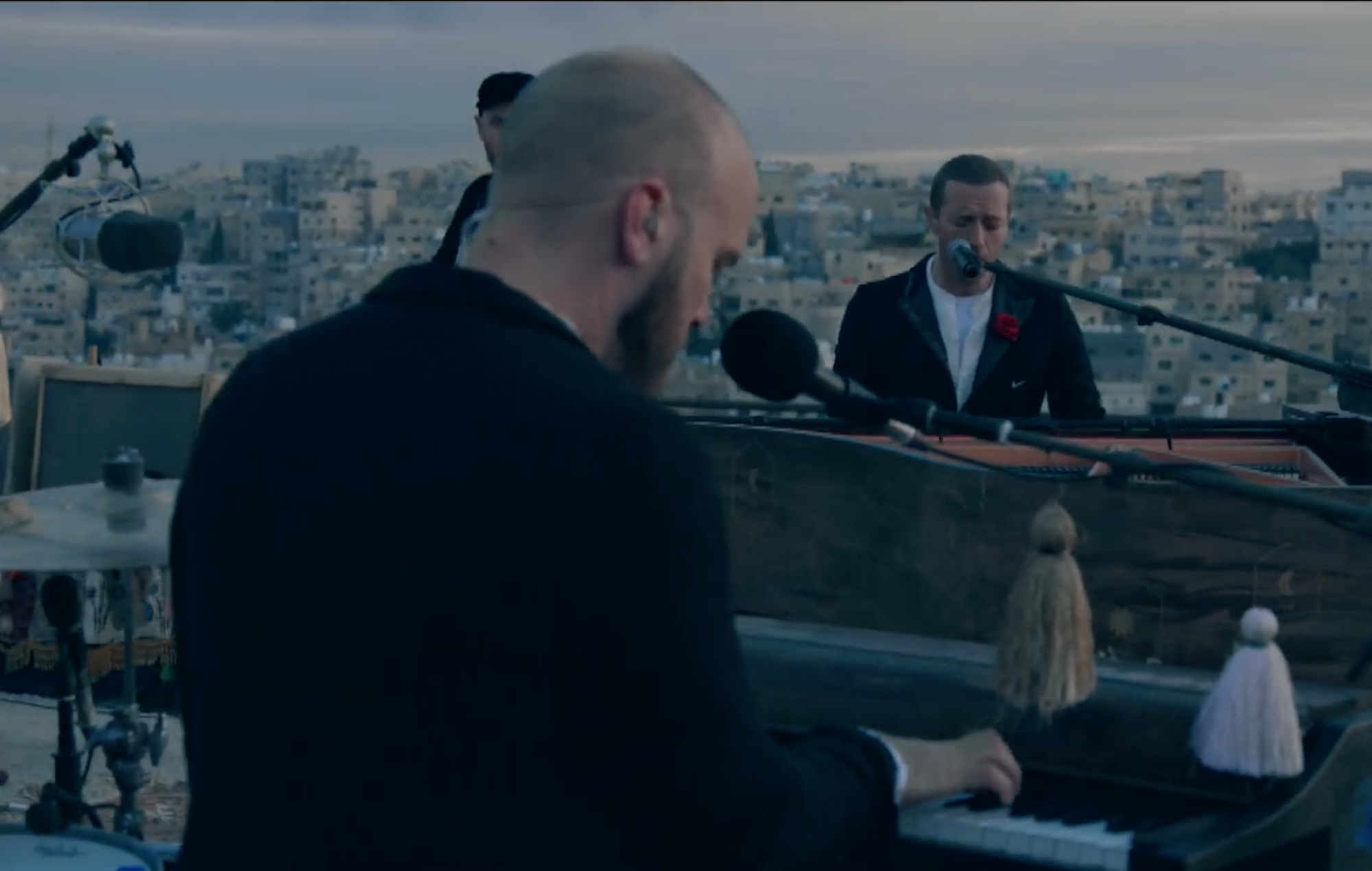 Watch Coldplay perform their new album 'Everyday Life' under a beautiful sunrise in Jordan